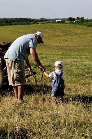 Dad and son on farm